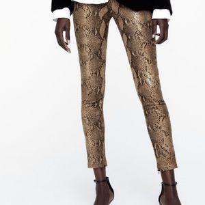 Snakeskin coated leggings